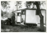 Early camper (car), two men