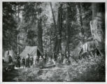 Camp scene with firearms, many people, Annie Creek Canyon, near Crater Lake