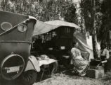 Couple camping with automobiles