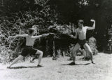 Fencing on the meadow at Neil Creek picnic,1938