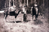Unidentified women campers with horses