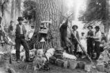 Huckleberry Mountain campers: Klamath Indians and others posed with buckets of berries and hanging...